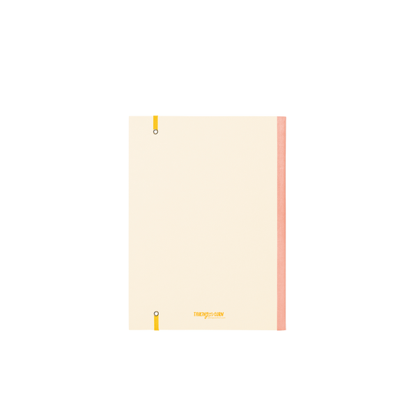 Back cover of a large cream planner with peach binding and yellow elastic closure.