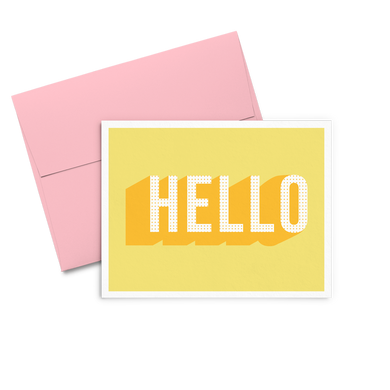 Hello Dots yellow greeting card with bold text and a pink envelope.