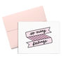 So Many Feelings is a cute greeting card with a pink banner and black script lettering.