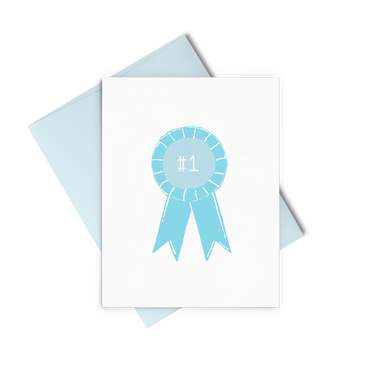 Letterpress greeting card showing a blue winning ribbon with a number one printed in the center.