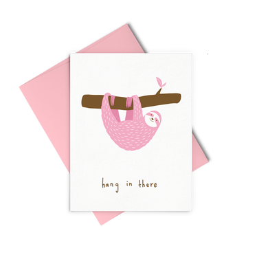 Hang In There is an encouraging greeting card of a pink sloth hanging on a tree branch.