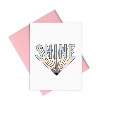 Shine greeting card is a bold graphic lettering and a pink envelope.
