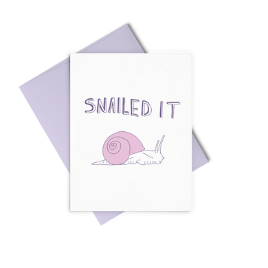 Snailed It is an encouraging greeting card with a purple snail and a purple envelope.