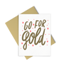 Go For Gold encouraging greeting card with gold and coral design and a gold envelope.