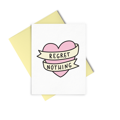 Regret Nothing is a cute greeting card with a pink bannered heart and a yellow envelope.