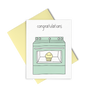 Baby cards that reads Congratulations and showing a mint green oven that has a little yellow muffin inside.
