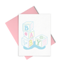 Baby cards showing four blocks with letters and illustrations on all sides in multiple colors and the letters spell out Baby.