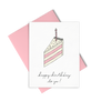 Letterpress greeting card showing a single slice of pink and cream layered birthday cake with a single candle and Happy Birthday To You written under the slice.