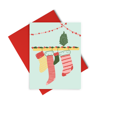 Stockings is a cute holiday greeting card of stockings hanging from a mantle.