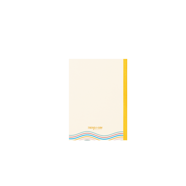 Back of a small, cream notebook with yellow binding and a few rainbow wavy lines at the bottom