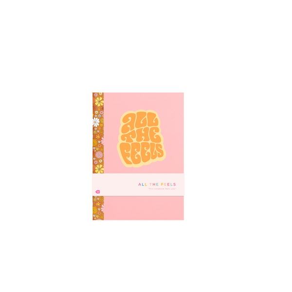 Cute pink notebook says All the Feels on the cover and has floral print binding on the spine. Shown wit point of sale bellyband.