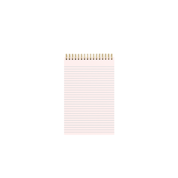 Inside pink page of a gold wire-bound taskpad showing a lined page design