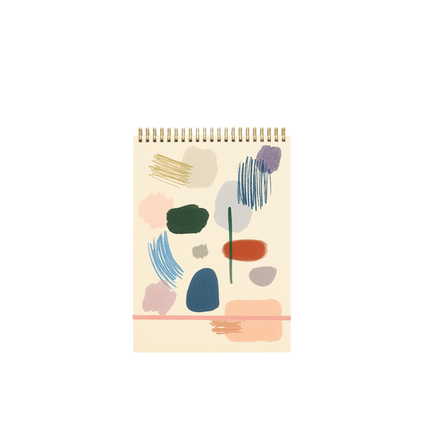 Large wire-bound taskpad with an abstract art pattern on the cover in muted colors.