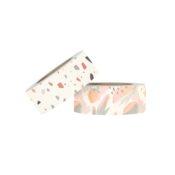 Two rolls of washi tape. The first is white with a  grey, blue, red, yellow and brown terrazzo pattern. The second roll is a watercolored botanical and fruit pattern in light green, corals, orange and pink.