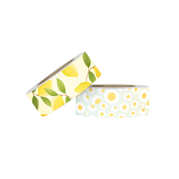 Two rolls of washi tape. The first is yellow with lemons and greenery. The second is an ombre background with white and yellow daisies.
