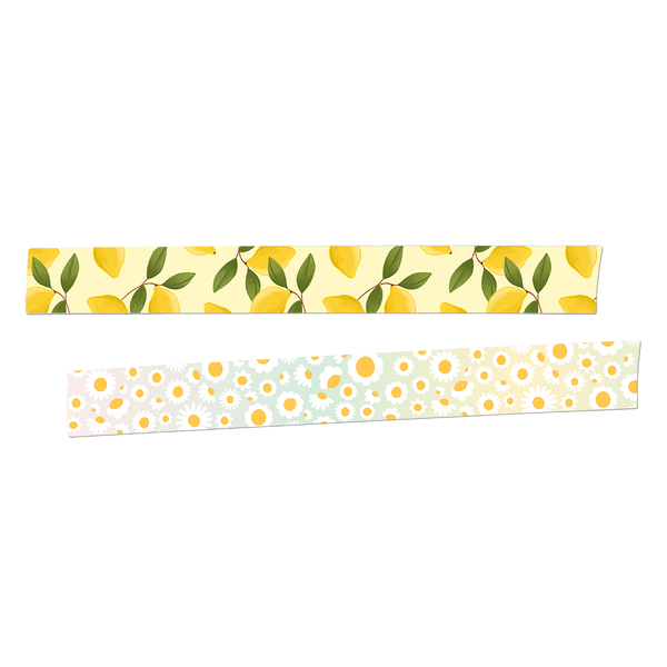 Two rolls of washi tape rolled out.  The first is yellow with lemons and greenery. The second is an ombre background with white and yellow daisies.