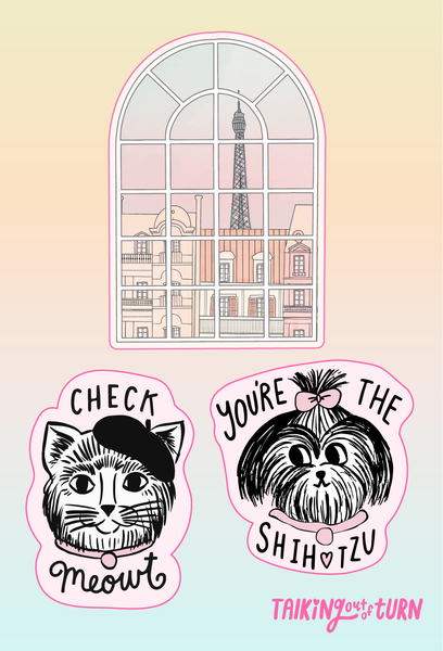 "A sticker set of the Eiffel Tower, a cat that says ""check meowt"" and a dog that says, ""you're the shihtzu"""