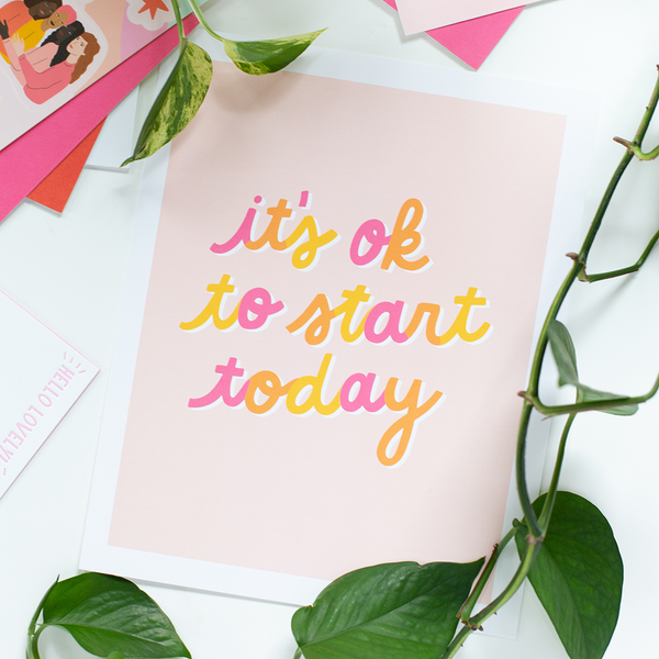 "A light pink poster with cursive script saying ""it's ok to start today"""