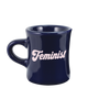 Navy blue diner funny coffee mug with Feminist written in pale pink hand lettered font.