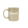 Feminist Sand Carved Metallic Mug is a funny coffee mug with engraved lettering in gold.