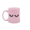 Pink funny coffee mug with thick black eyelashes printed on the front.