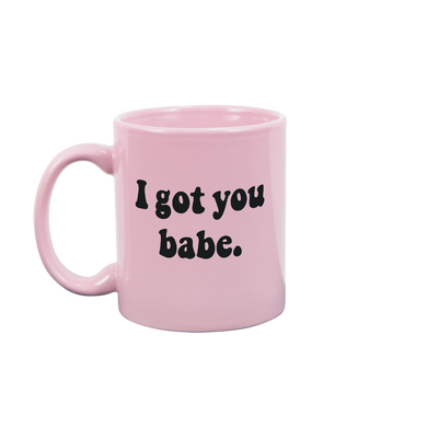 Funny coffee mug in pink with I Got You Babe written in a heavy black font with a 70s vibe.