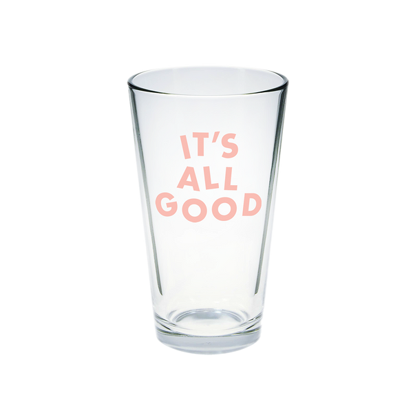 Clear glass pint glass with It's All Good printed in pink.