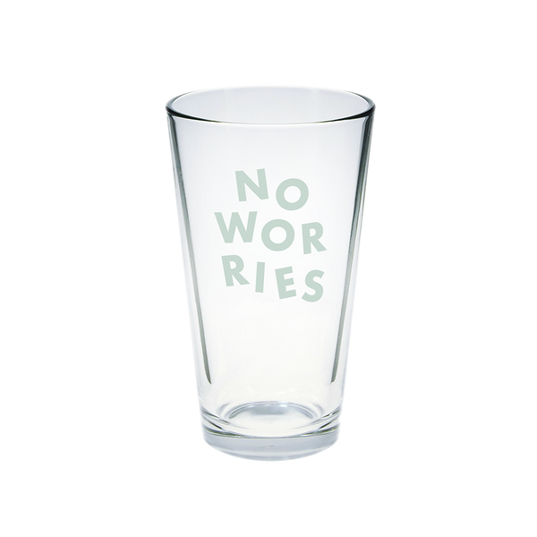 Clear glass pint glass with No Worries printed in powder blue.