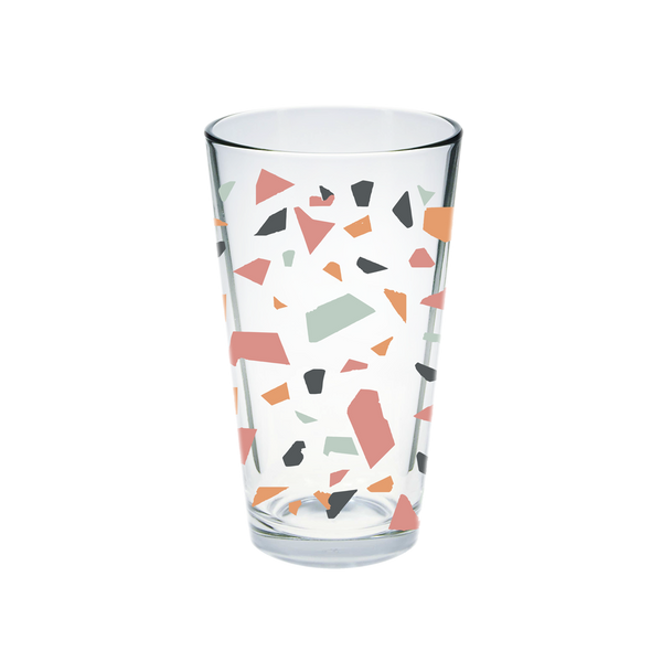 Clear glass pint glass with multi-colored terrazzo pattern.
