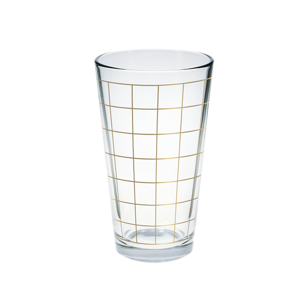Glass pint glass with gold grid print.