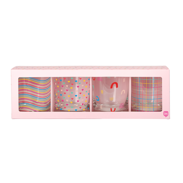 Set of 4 rocks glasses with rainbow print designs in pink box packaging.