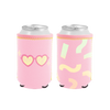 Outta Here Reversible Can Cooler is bright pink with heart sunglasses design that flips to pastel macaroni pattern.
