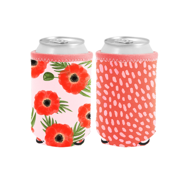 Poppies Reversible Can Cooler is red with pink dots and pink with red poppies on the reverse.