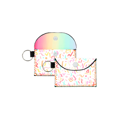Party Animal Bend and Snap is a cute cardholder in reversible neoprene in rainbow confetti and rainbow ombre patterns.