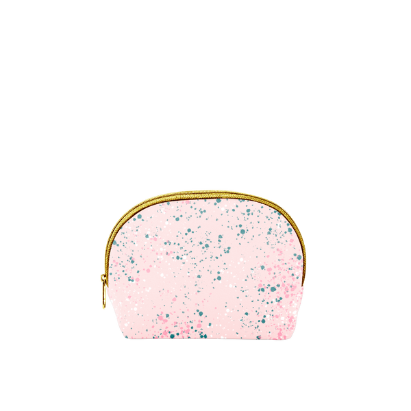 Small cosmetics bag in blush pink with paint splatter print and a gold zipper.