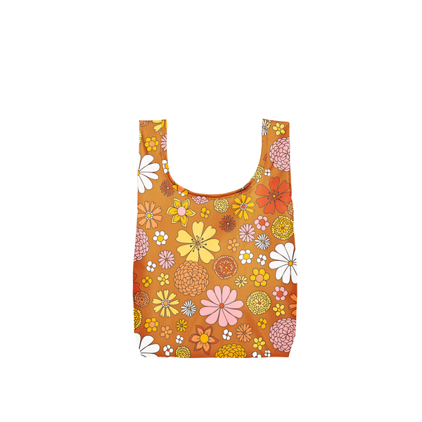 A small, burnt orange reusable tote with yellow, white, pink and multi-colored flowers.