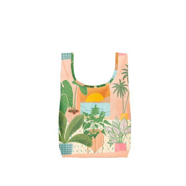 A costal scene out a window with potted plants surrounding the window on a small reusable tote.