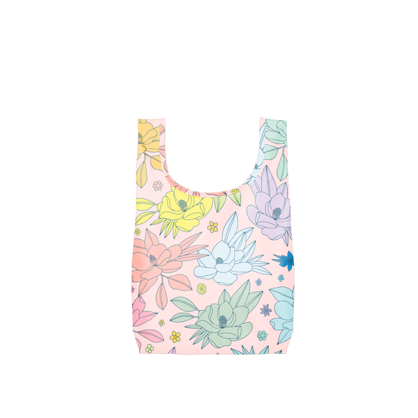 A small pink reusable tote with multi-colored magnolia flowers.