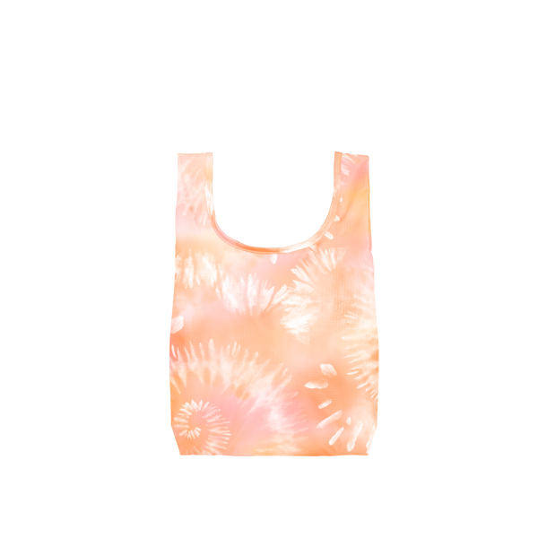 A small orange, light pink and white tie dye reusable tote.