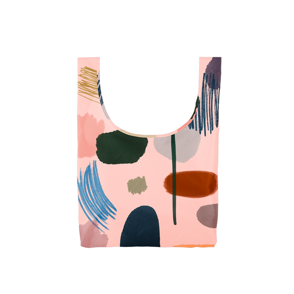 Twist and Shout Everyone's an Artist is a medium, cute reusable tote bag in light pink with abstract painterly design.