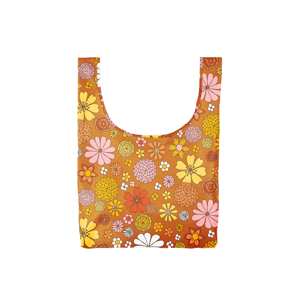 A medium, burnt orange reusable tote with yellow, white, pink and multi-colored flowers.