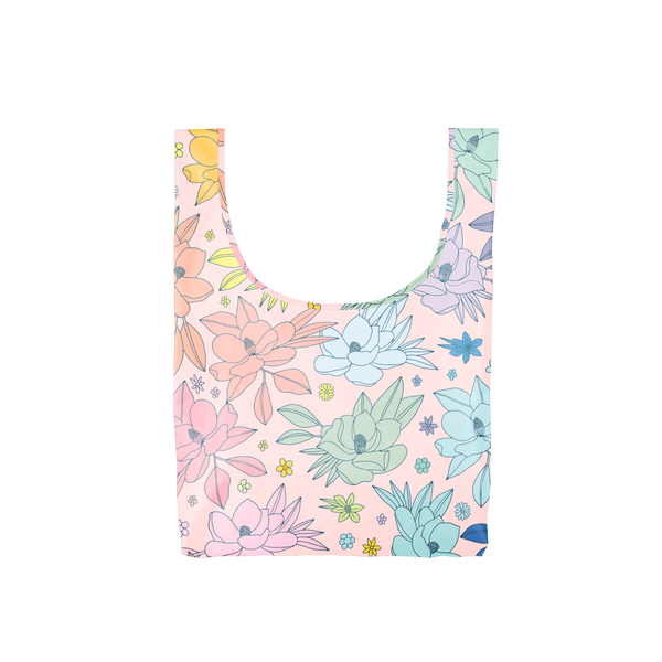A medium pink reusable tote with multi-colored magnolia flowers.