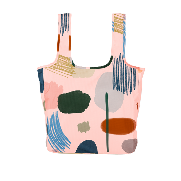 Twist and Shout Everyone's an Artist is a large, cute reusable tote bag in light pink with abstract painterly design.