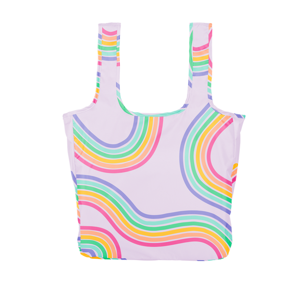 A large purple reusable tote with rainbow paths twisting on and off the tote.