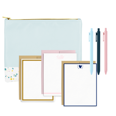Cute stationery kit with a blue splatter pencil pouch, set of letter pressed cards, and three pastel pens.