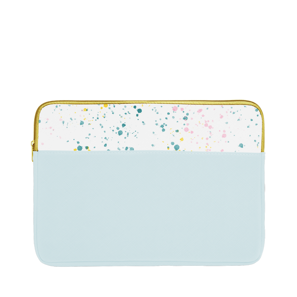 Powder blue laptop sleeve with white paint splatter trim, a gold zipper, and 13 inch size.