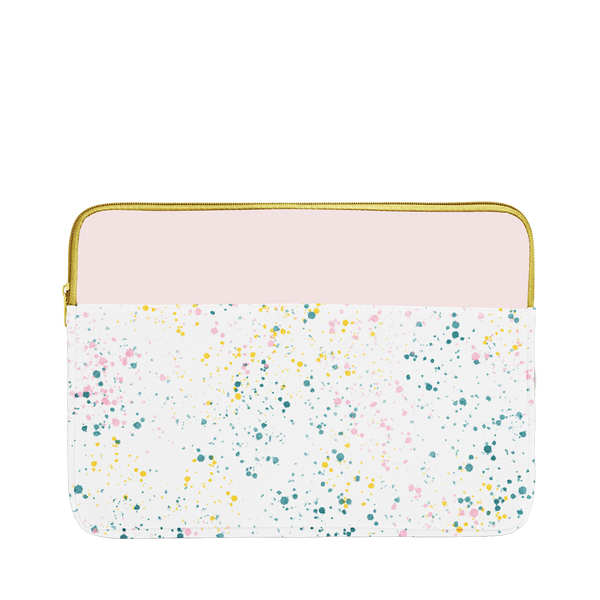 White paint splatter print laptop sleeve with blush pink trim, a gold zipper, and 13 inch size.
