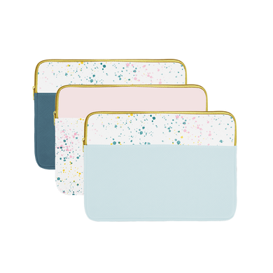 Three laptop sleeves with gold zippers; one powder blue splatter, one blush pink splatter, and one spruce green splatter.