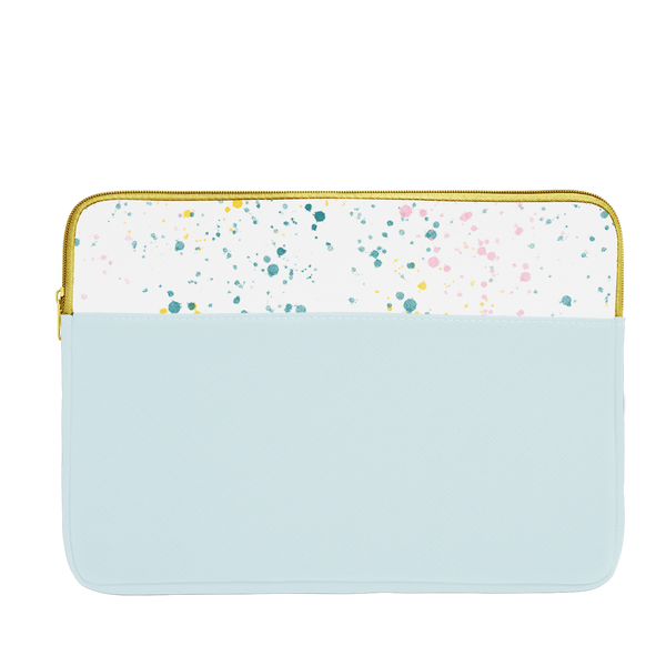 Powder blue laptop sleeve with white paint splatter trim, a gold zipper, and 15 inch size.