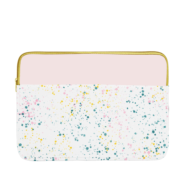 White paint splatter print laptop sleeve with blush pink trim, a gold zipper, and 15 inch size.